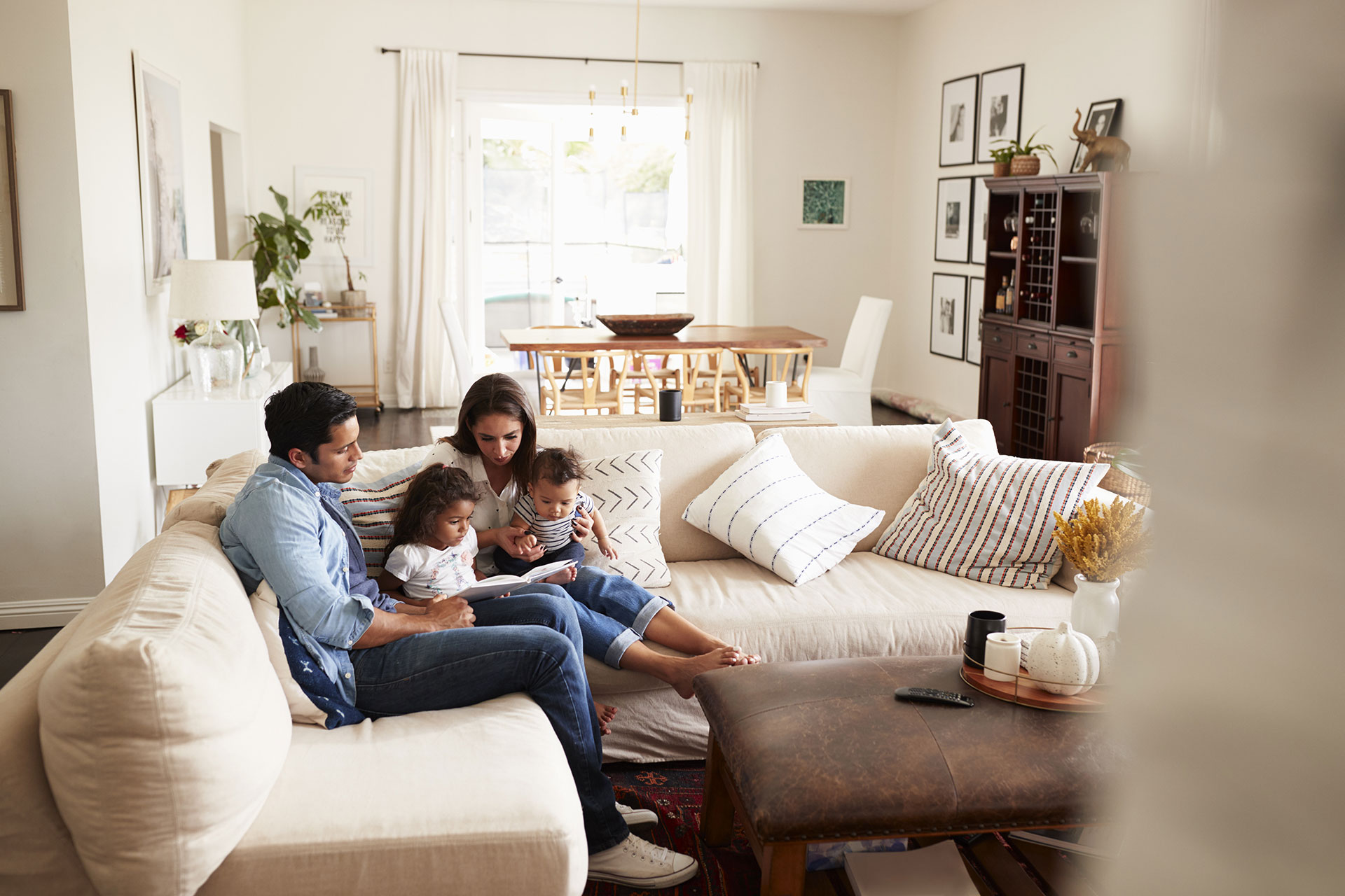 family reading a book on couch